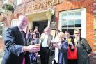 Douglas Hughes, left, celebrating his retirement after 40 years as a solicitor in Wiltshire