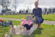 Families are concerned about the removal of flowers and objects from graves. Pictured Karen Thompson at her daughter Mya's grave. Picture: THOMAS KELSEY