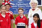 Councillor Teresa Page meets pupils of St Mary's and St Catherine's Catholic primary schools. Picture: VICKY SCIPIO