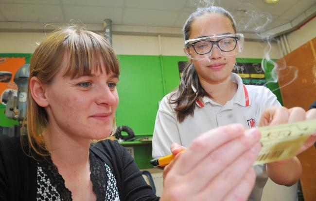 Catherine Hall works with Holly during the engineering day at Kingsdown School. Picture: DAVE COX