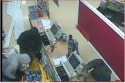 CCTV images police have released of the raid at Tesco