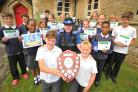 South Marston primary school pupils receive their Junior Good Citizen prizes from PCSO Mandi Coles. Picture: DAVE COX