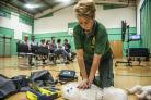 Sharon Kirwan demonstrates the new defibrillator at Isambard Community School. Picture by Thomas Kelsey