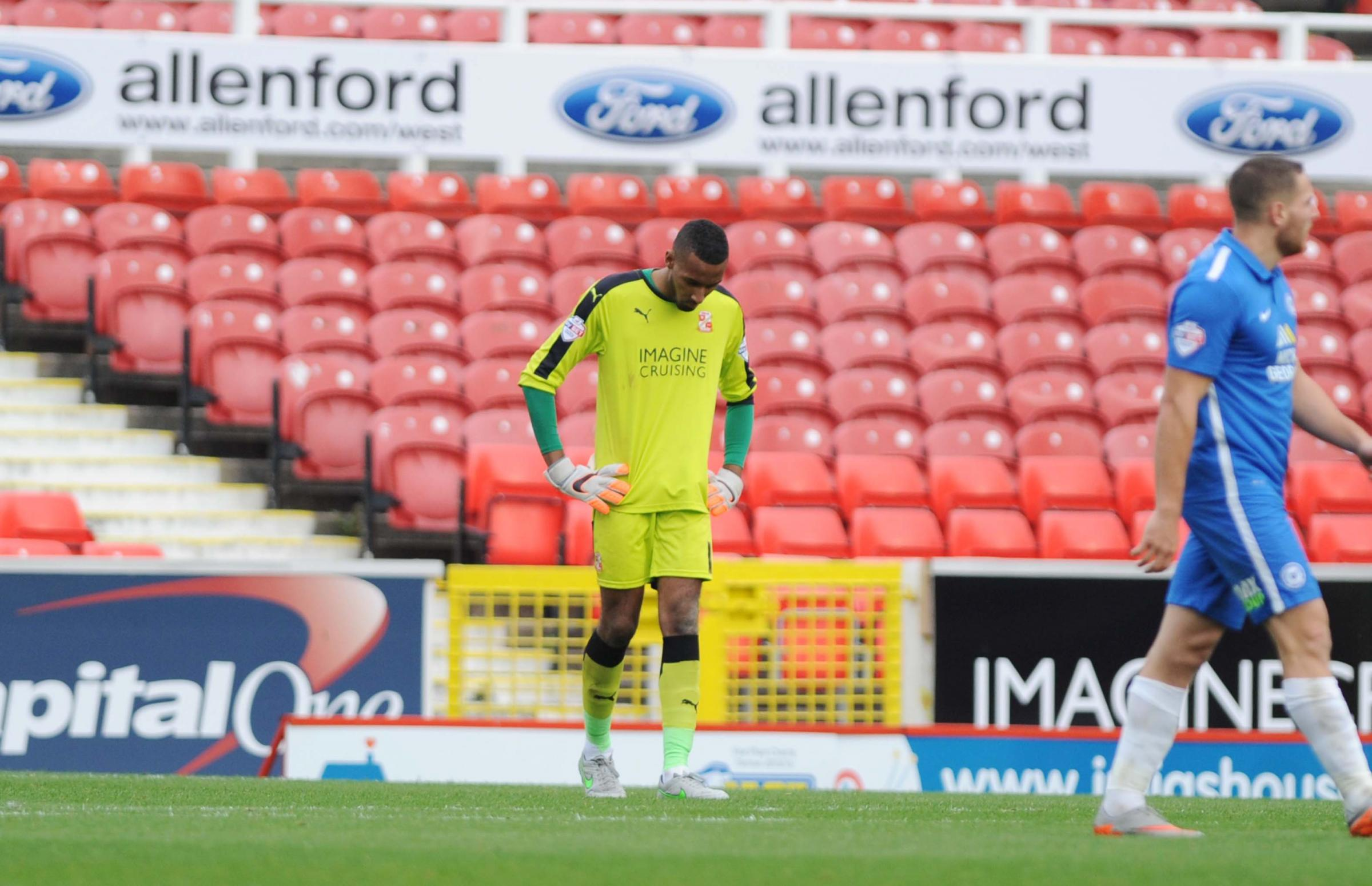 Lawrence Vigouroux is dejected after conceding a second goal