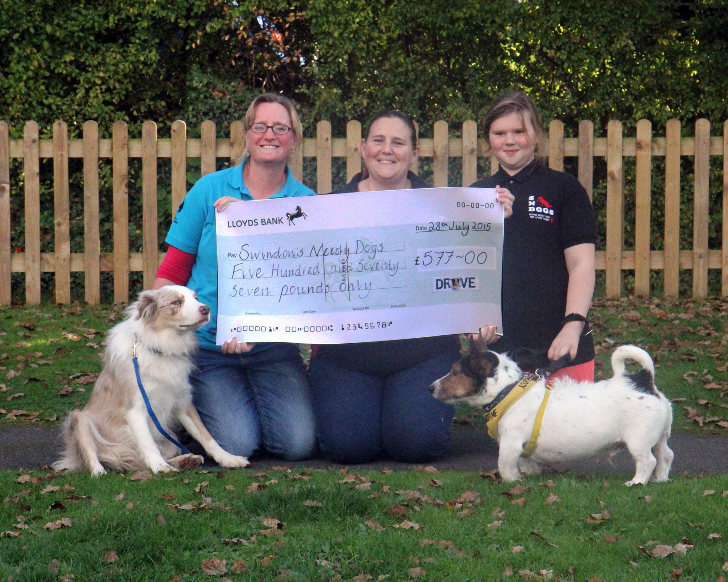 Donna McDonnell from Drove Vets, Jess and Dru Bascombe of SNDogs. Picture by Josie Williams