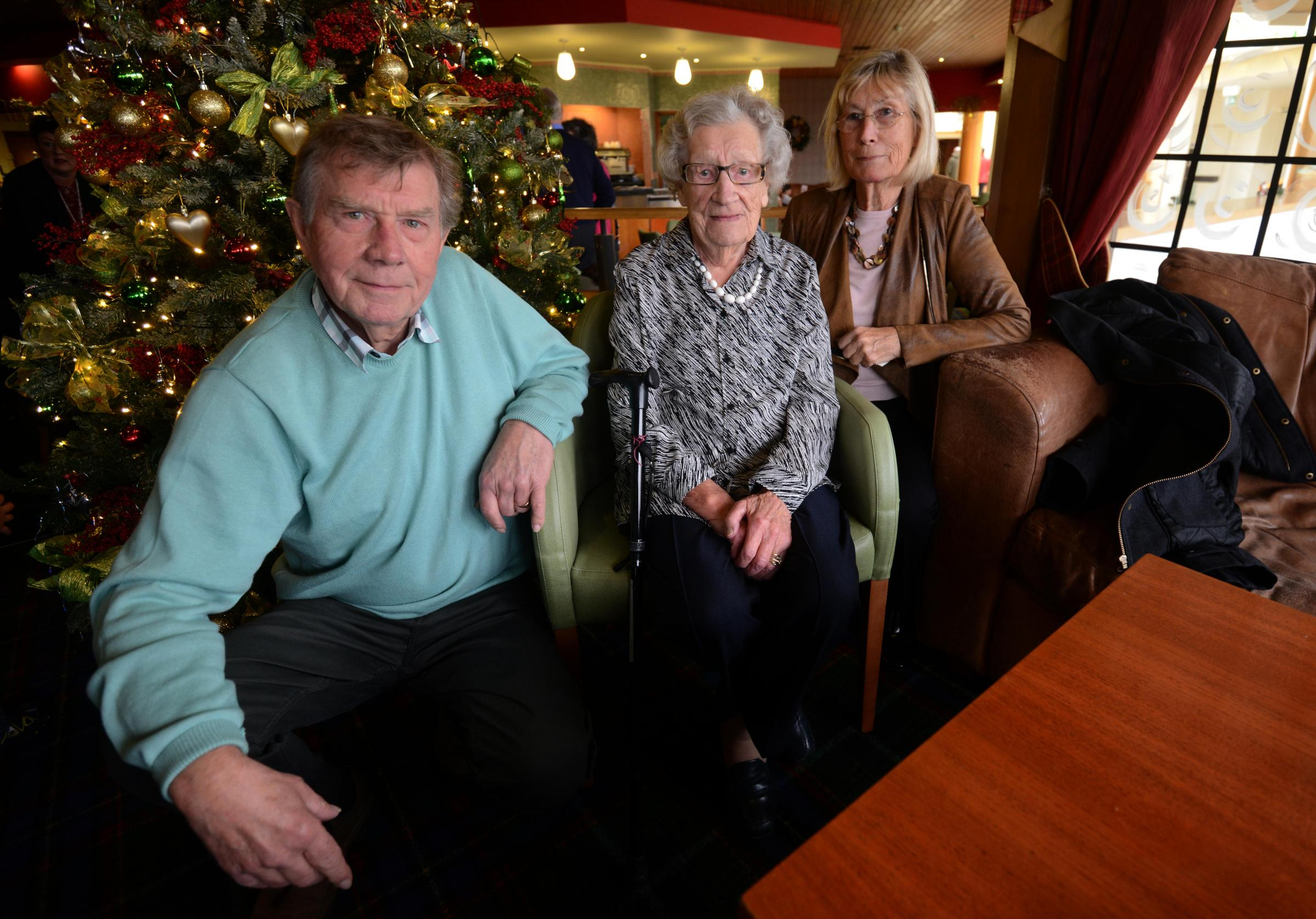 Violet Ewen celebrated her 100th birthday at Blunsdon House Hotel with son Clive Ewen (left) and daughter Mavis Cork.