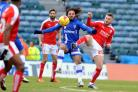 Gillingham's Bradley Dack tries to hold off Anton Rodgers on Saturday Picture: DAVE EVANS