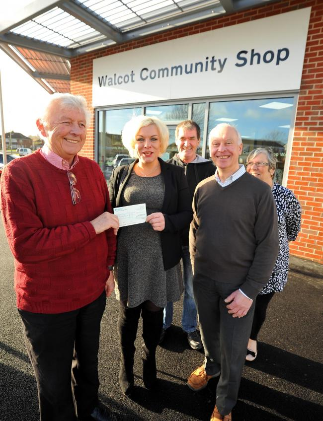 Swindon Womens Aid was one of a number of good causes to benefit from the money raised at the Walcot charity shop, which also supports the library. Peter Mallinson presents Olwen Kelly with a cheque