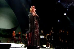 Adele drops lots of f-bombs as she kicks off her Glastonbury set but everybody adores her