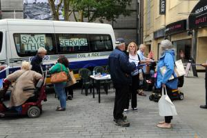 Volunteers and service users collecting signatures for the petition to save Dial-A-Ride.