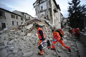 Rescue crews at the scene in Italy. (AP Photo/Sandro Perozzi)