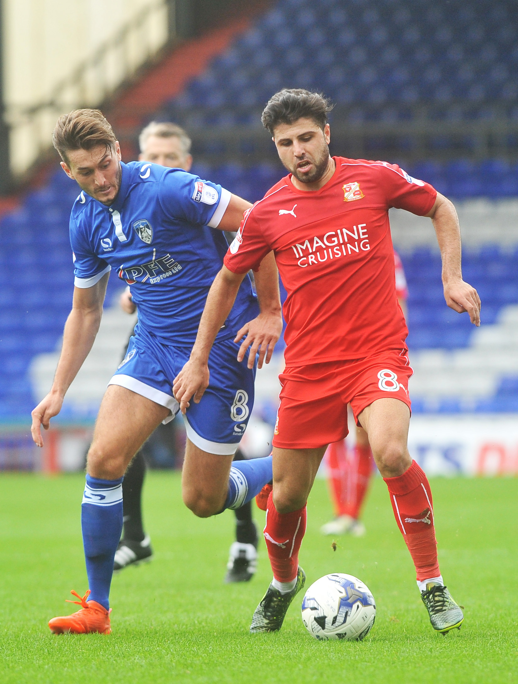 Ollie Banks in action against former Town man Yaser Kasim in a game against Oldham last season