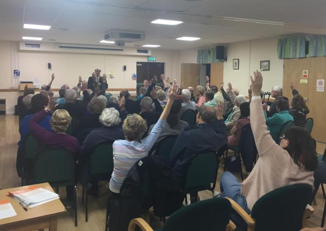 A show of hands to indicate opposition to parishing.