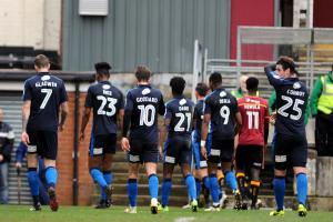Dion Conroy (far right) and the rest of the Swindon Town players trudge off dejected at full-time against Bradford City