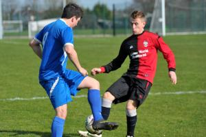 Sport 4 Pinehurst's Brad Stanners (red and black) battles with Chiseldon's Aaron Smith. PICTURE: DAVE COX
