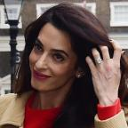Swindon Advertiser: Amal Clooney stunned in a gorgeous red dress as she gave a speech in London