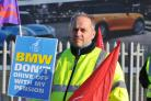 BMW worker Nico Albanese on the picket line yesterday    Picture: DAVE COX