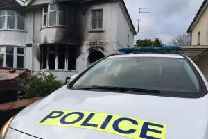 Police wait for the house to be boarded up after the fire early today. Picture: Royal Wootton Bassett Police