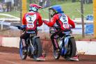 Swindon Robins riders Jason Doyle (left) and Nick Morris celebrate their 5-1 victory over Rye House Rockets in Heat 13 last night - a win that secured their side's overall success at the Abbey Stadium. PICTURE: LES AUBREY