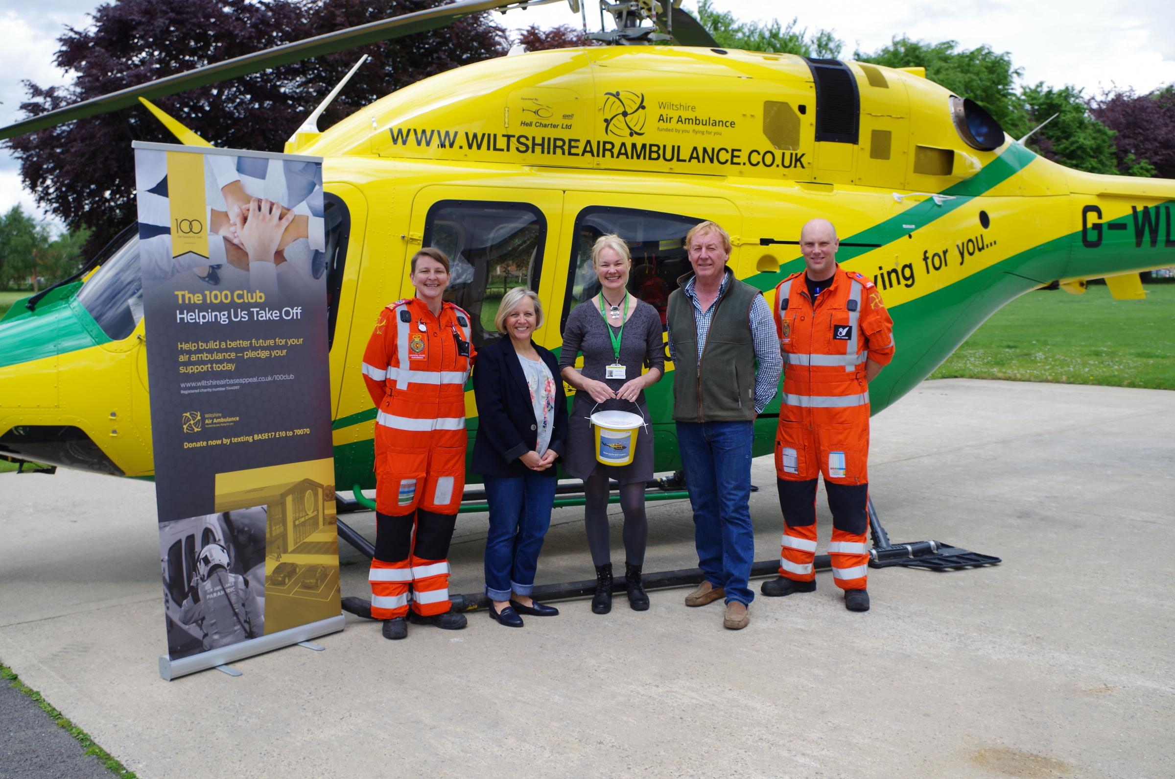 Valerie Whistler, Wiltshire Air Ambulance partnerships co-ordinator with Alison and Jonathan Sinclair, owners of Lowden Garden Centre, and WAA paramedics
