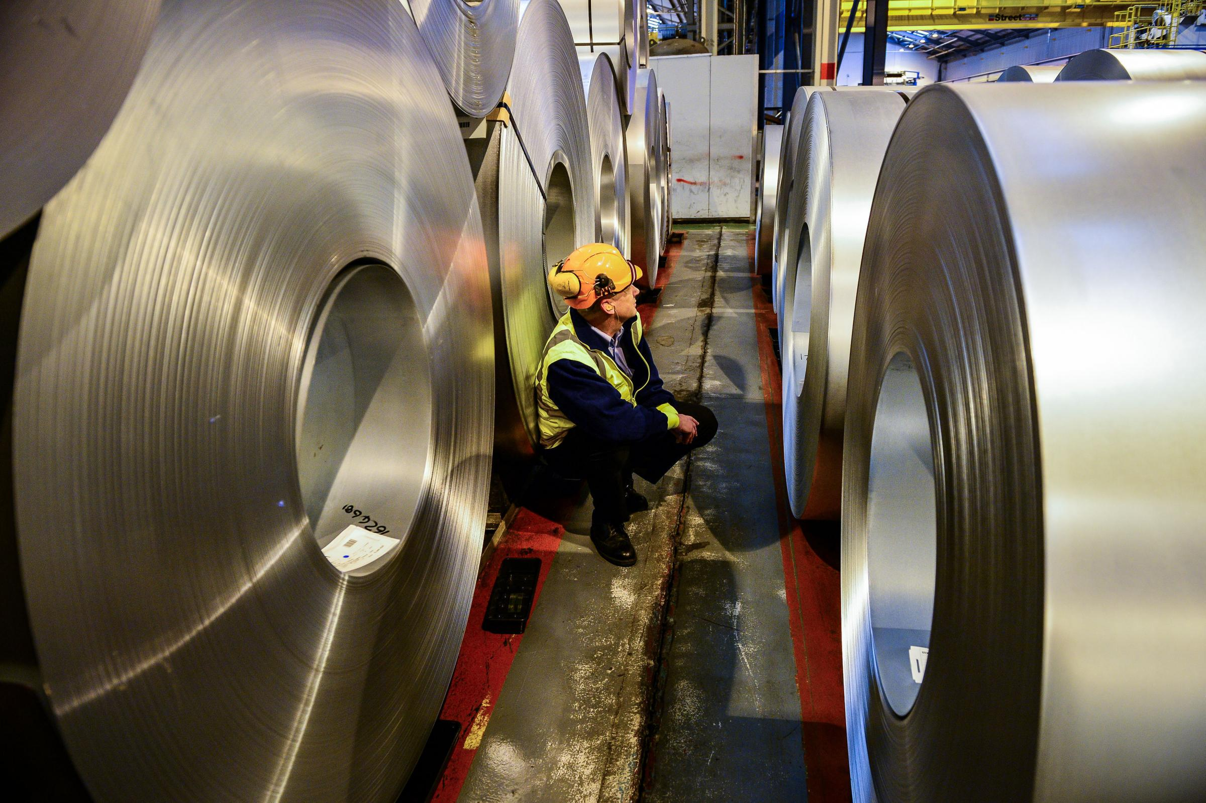 File photo dated 15/02/17 of a worker inspecting rolls of steel. Britain's factories enjoyed a welcome bounce-back in July thanks to the strongest surge in export orders for more than seven years. PRESS ASSOCIATION Photo. Issue date: Tuesday August 1,
