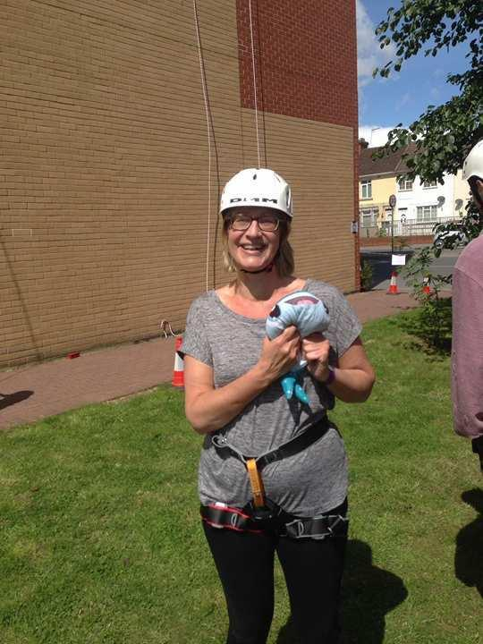 Sarah Forbes with The Chalet School's mascot Destiny after abseiling down Jurys Inn.