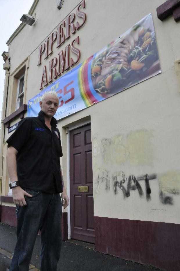 Landlord Kevin Holland with the homophobic graffiti at the Pipers Arms
