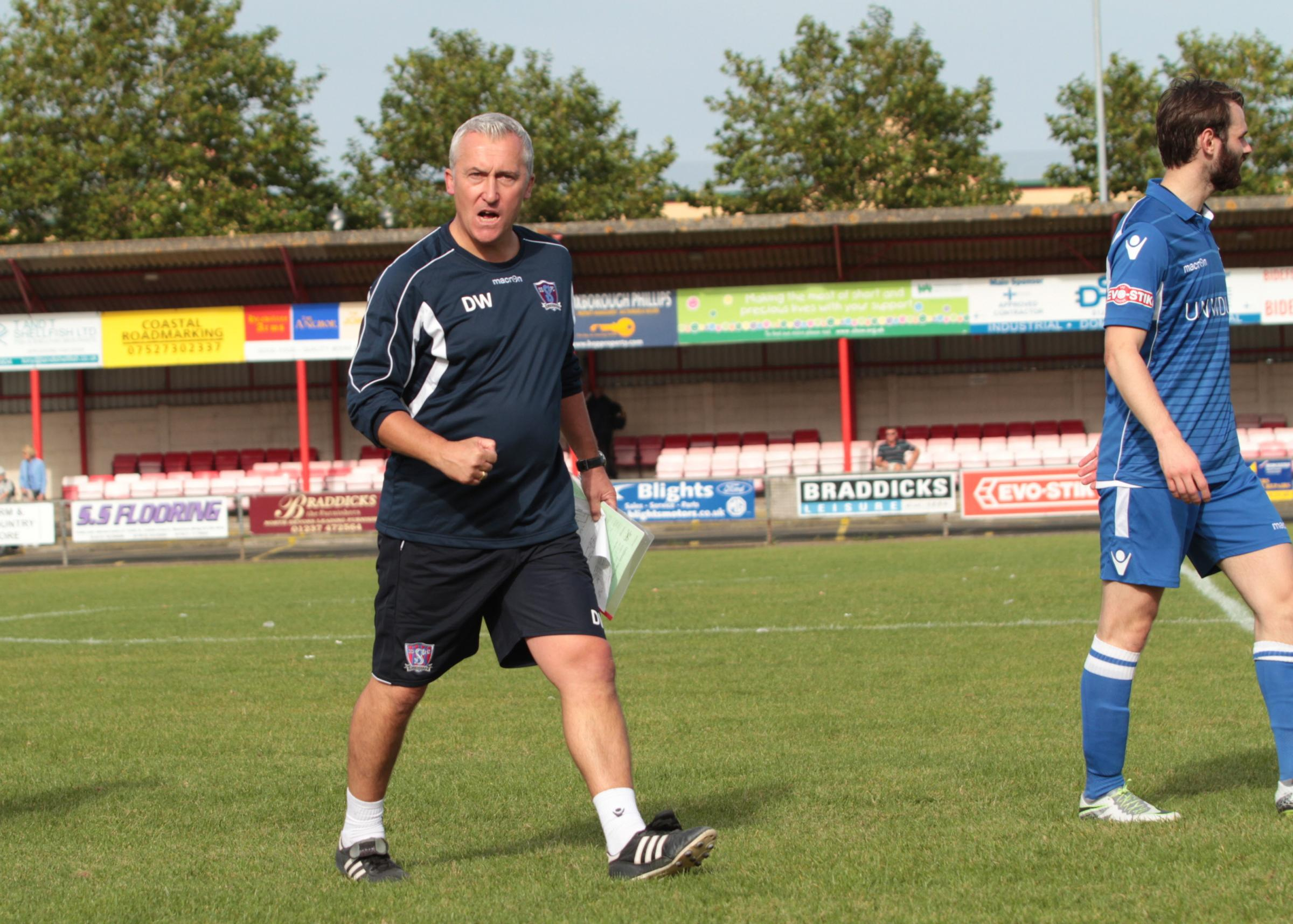 Swindon Supermarine manager Dave Webb celebrates his side's win at Bideford on Saturday
