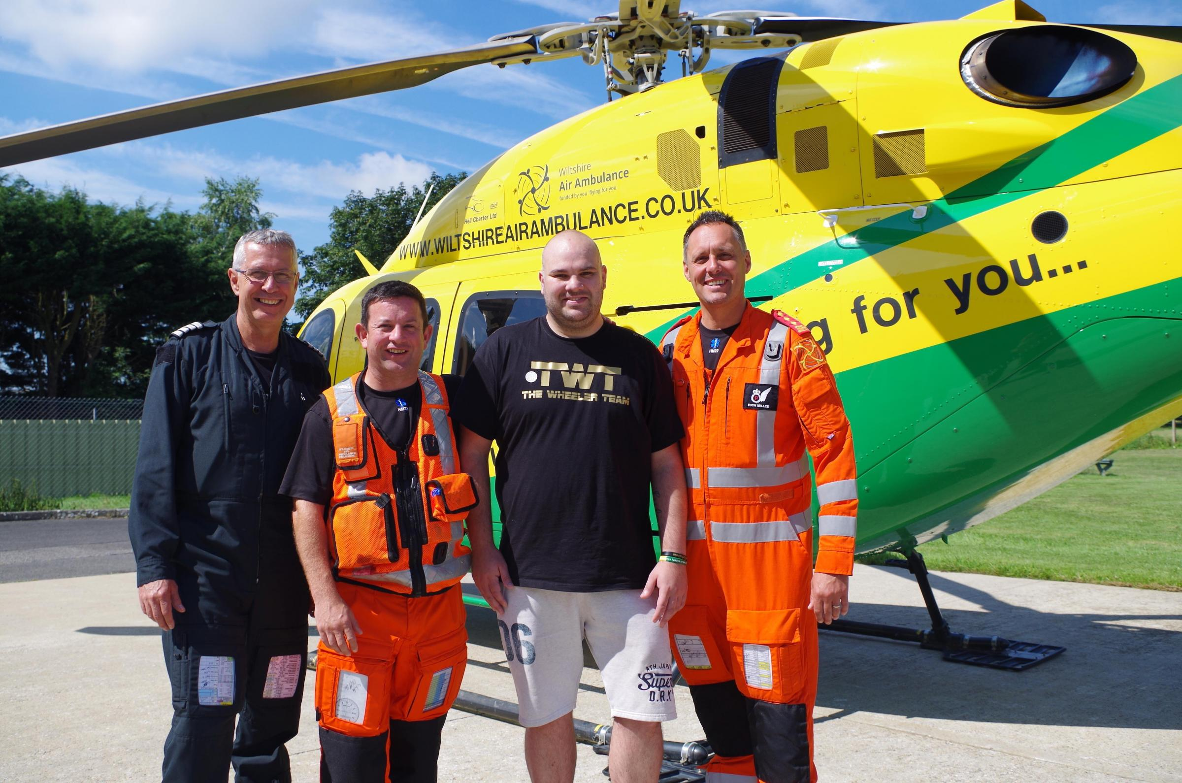 Kieron Reeson (third from left) with the Wiltshire Air Ambulance Crew who attended him, Pilot George Lawrence and Paramedics Fred Thompson and Richard Miller.