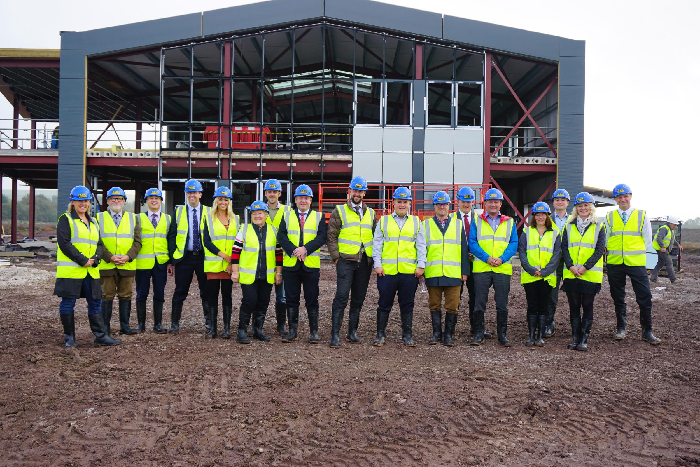 Members of Wiltshire Air Ambulance's 100 Club at the charity's new airbase under construction at Outmarsh Farm, Semington