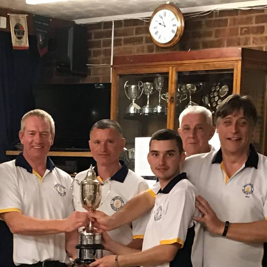 Westlecot's winning foursome Ray Sowden, Kevin Carter, James Richman and Miles Roberts with Swindon president Bob Hiles