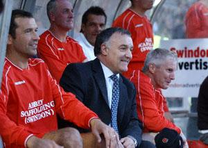 Former Town boss Lou Macari, above with ex-skipper Colin Calderwood, believes there is too much money in the modern game.