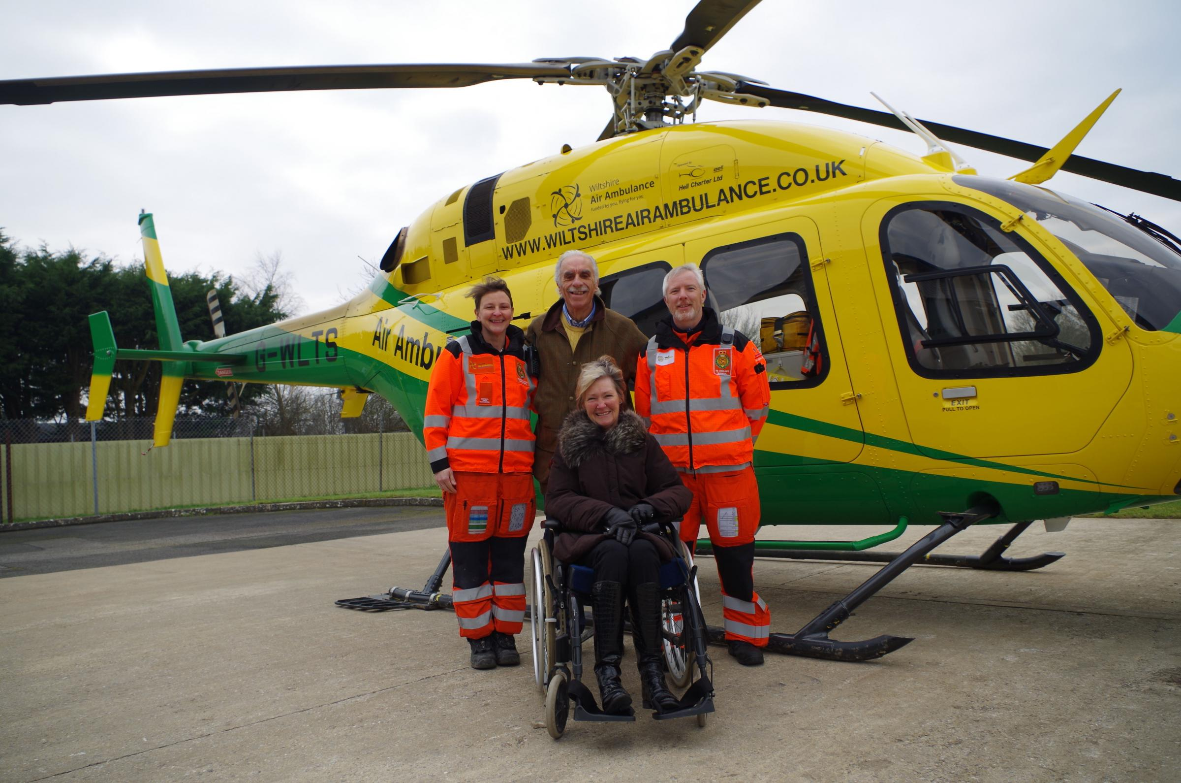 Annette Tavener with her husband Peter and Wiltshire Air Ambulance paramedics Louise Cox and Steve Riddle.