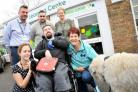 left 2 right .Pic -  Gemma Matts, Genti Mullaliu, Karl Foulkes, James Lewis ( below ), Maria Beeden, Janet .Garrett with Mack - dog.Date 31/10/18.Pic By Dave Cox.Uplands Education Trust will recieve Janet's last defib donation..