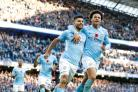 Manchester City's Sergio Aguero and Leroy Sane celebrate (Martin Rickett/PA)
