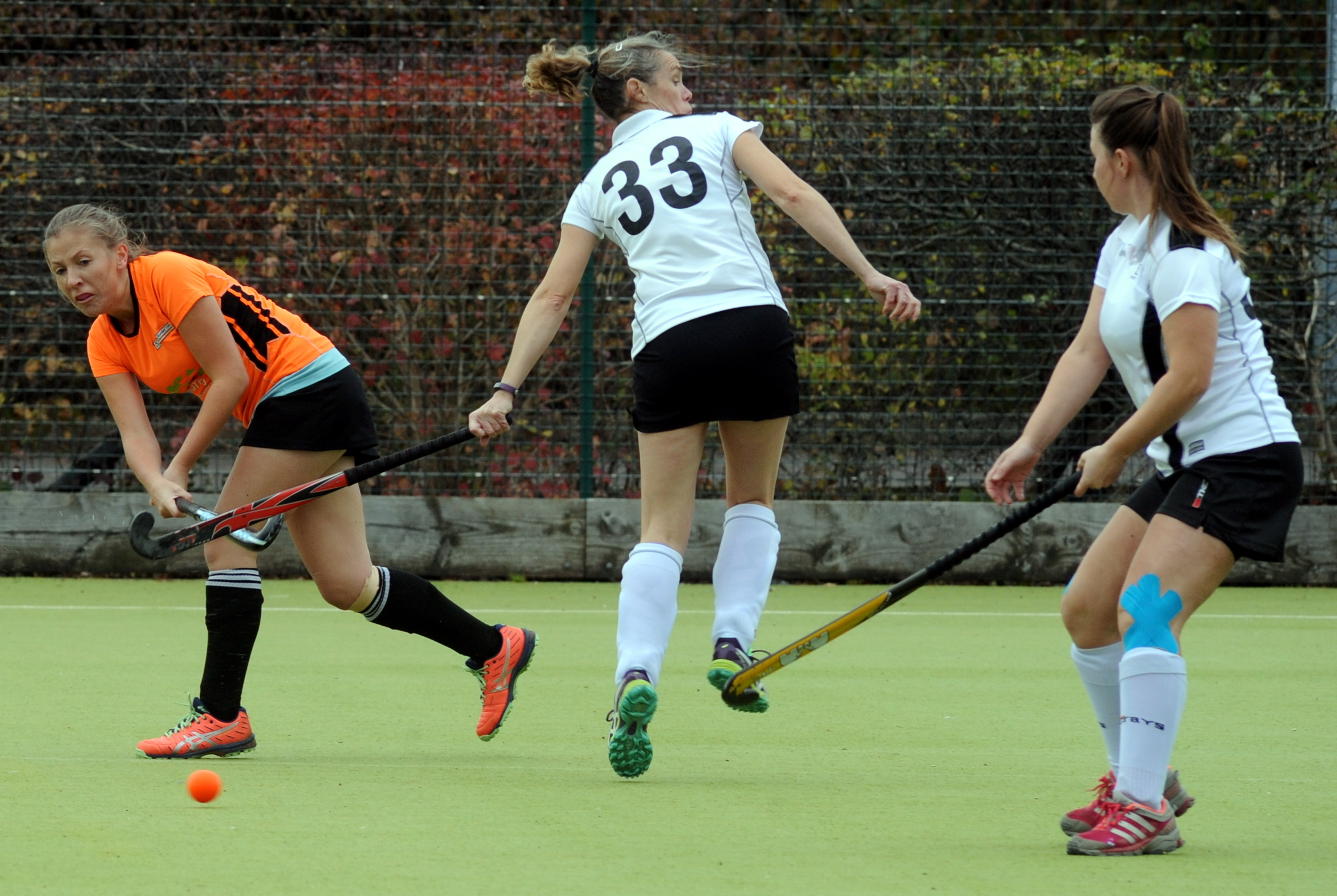 Swindon 2nd's Jenny Cooper (orange) drills the ball forward against Salisbury   Picture: PAUL NICHOLLS