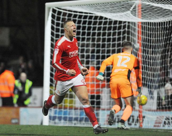 Luke Norris celebrates after scoring the injury-time match-winning penalty against Chesterfield