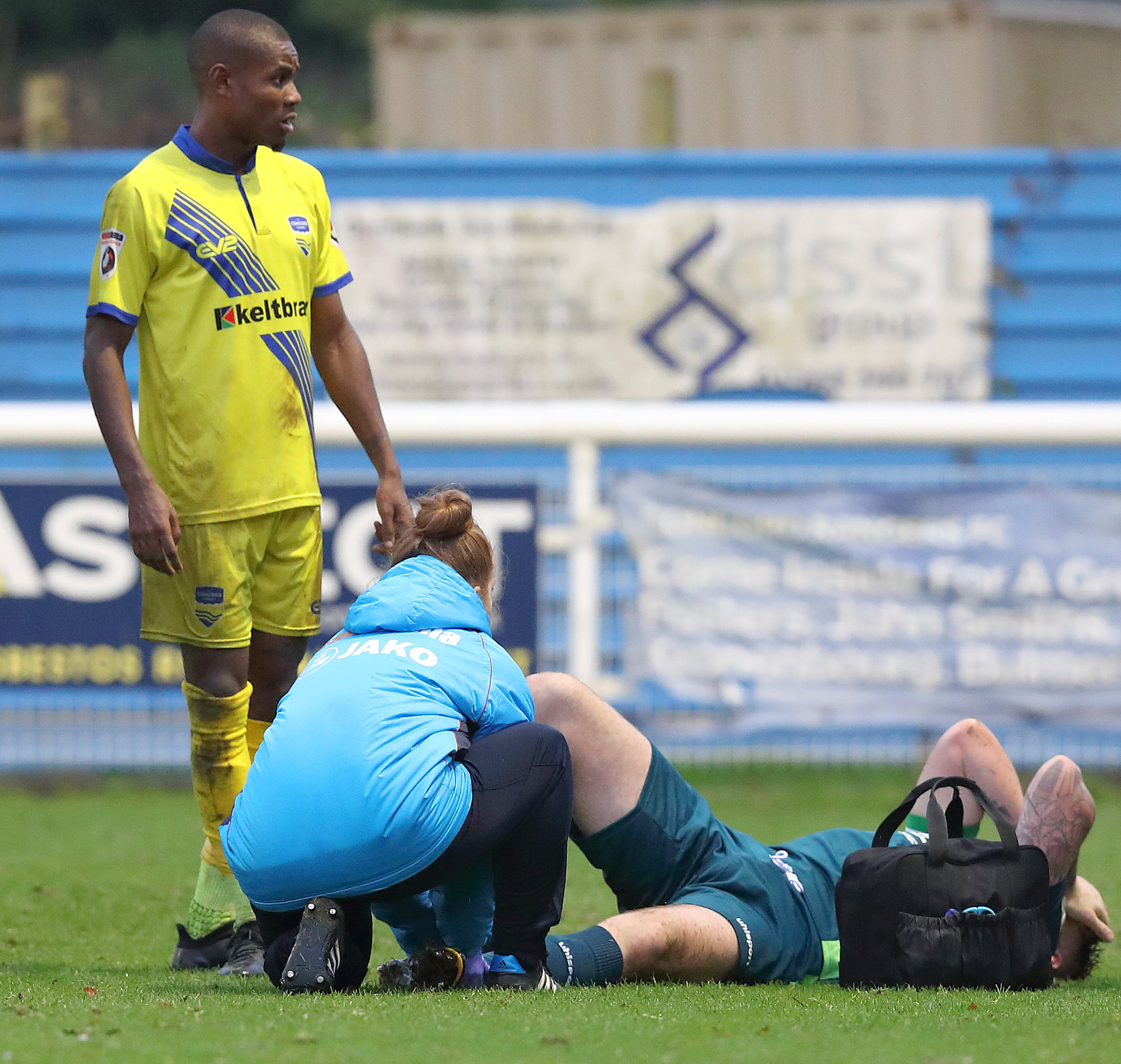 Chippenham Town skipper Greg Tindle is treated by physio Charlotte Soffe before being substituted on Saturday Picture: RICHARD CHAPPELL