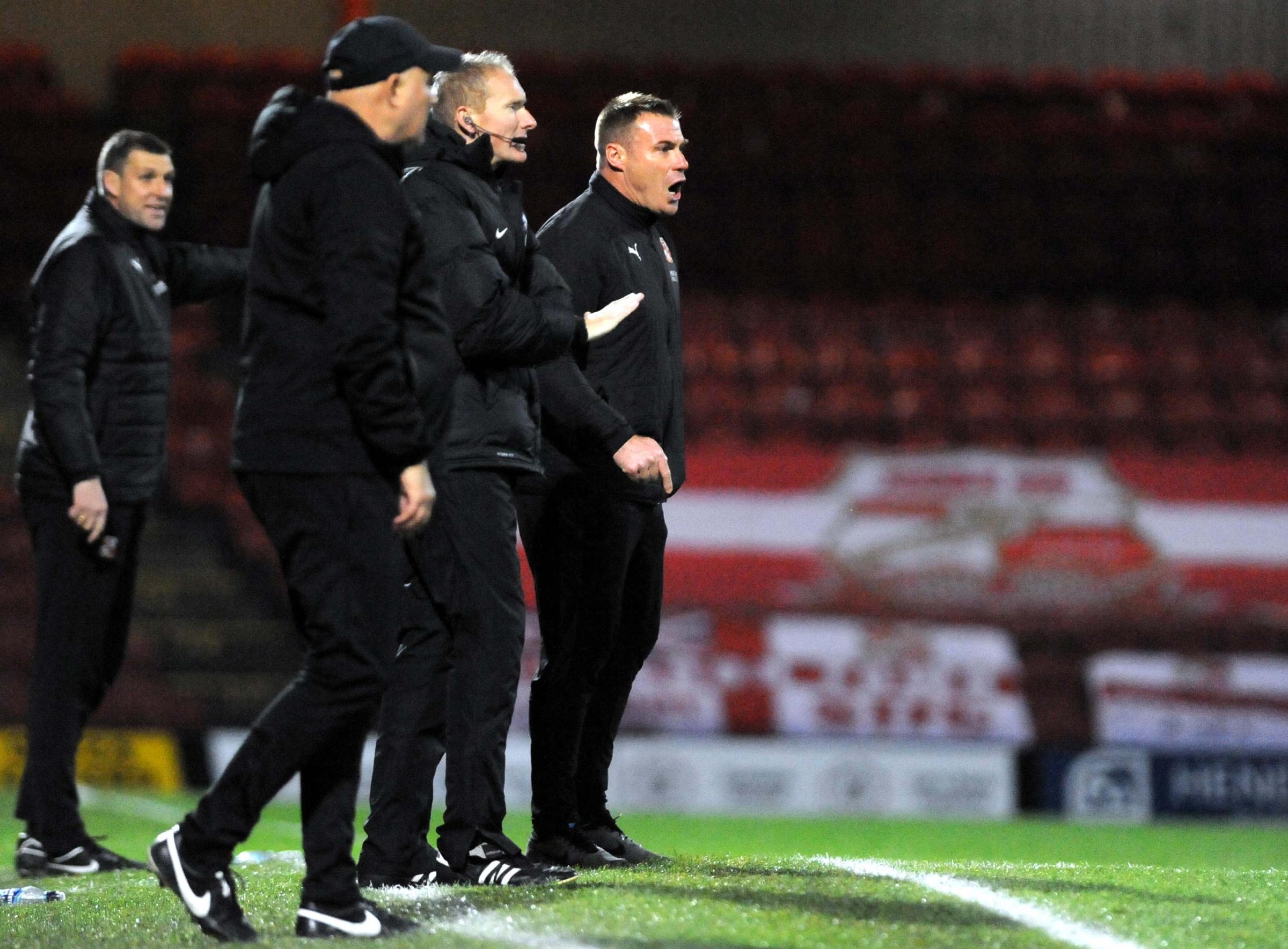 Swindon Town manager David Flitcroft shouts his instructions from the touchline at Grimsby