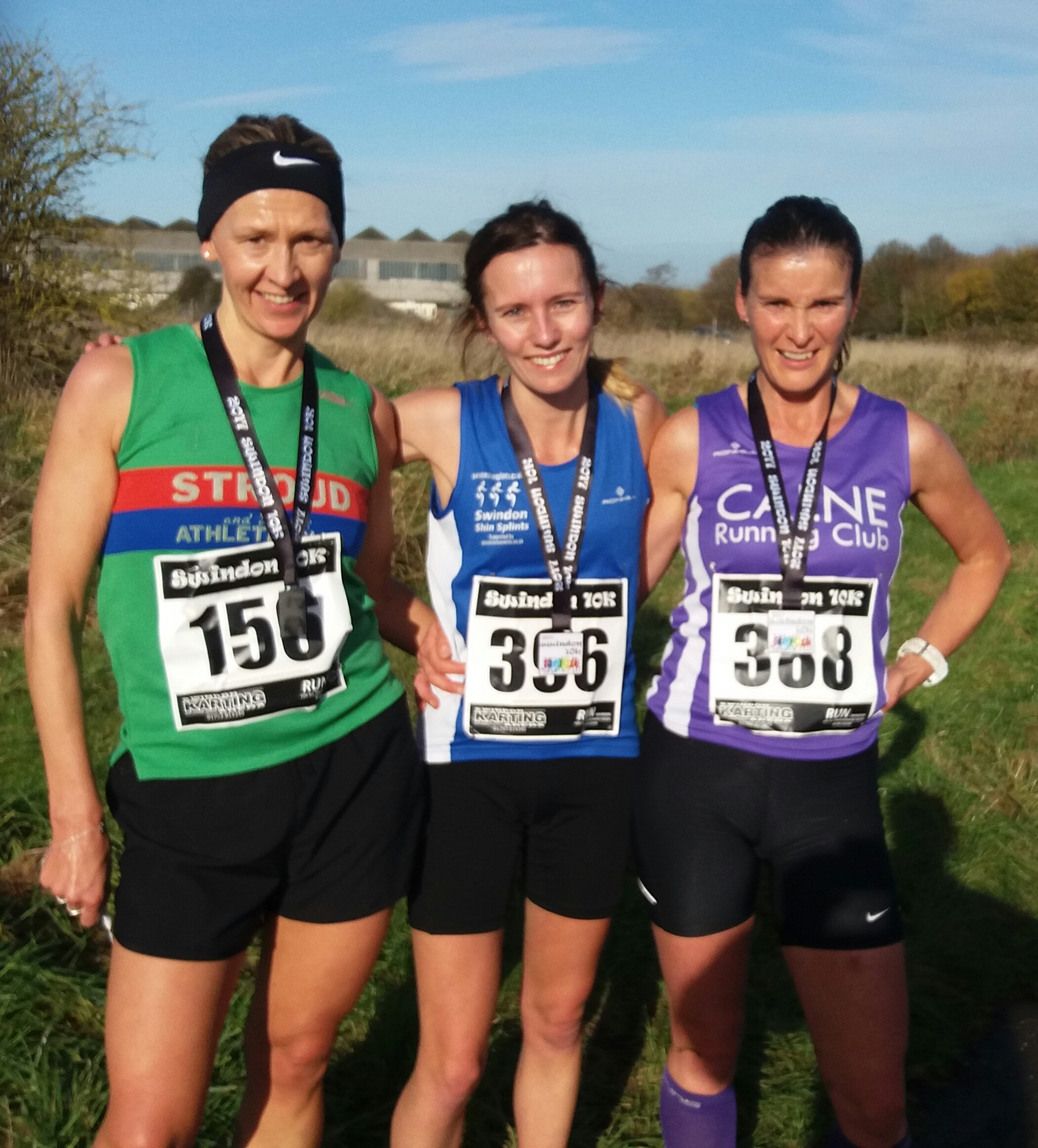Catie O'Donoghue on top of the podium, flanked by Jo Fifield (left) and Denise Nott at the Swindon 10k