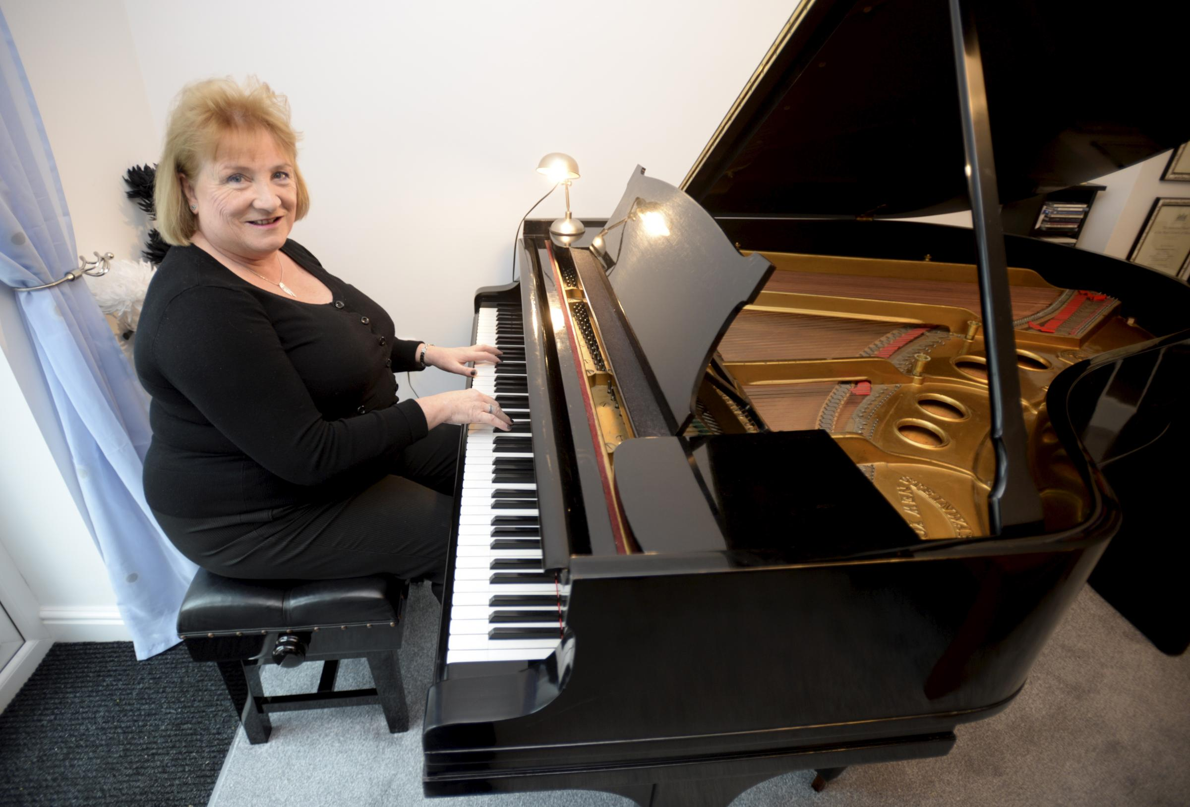 Pianist Julie Johnson-Little playing her piano at home in Swindon, Picture: PAUL NICHOLLS
