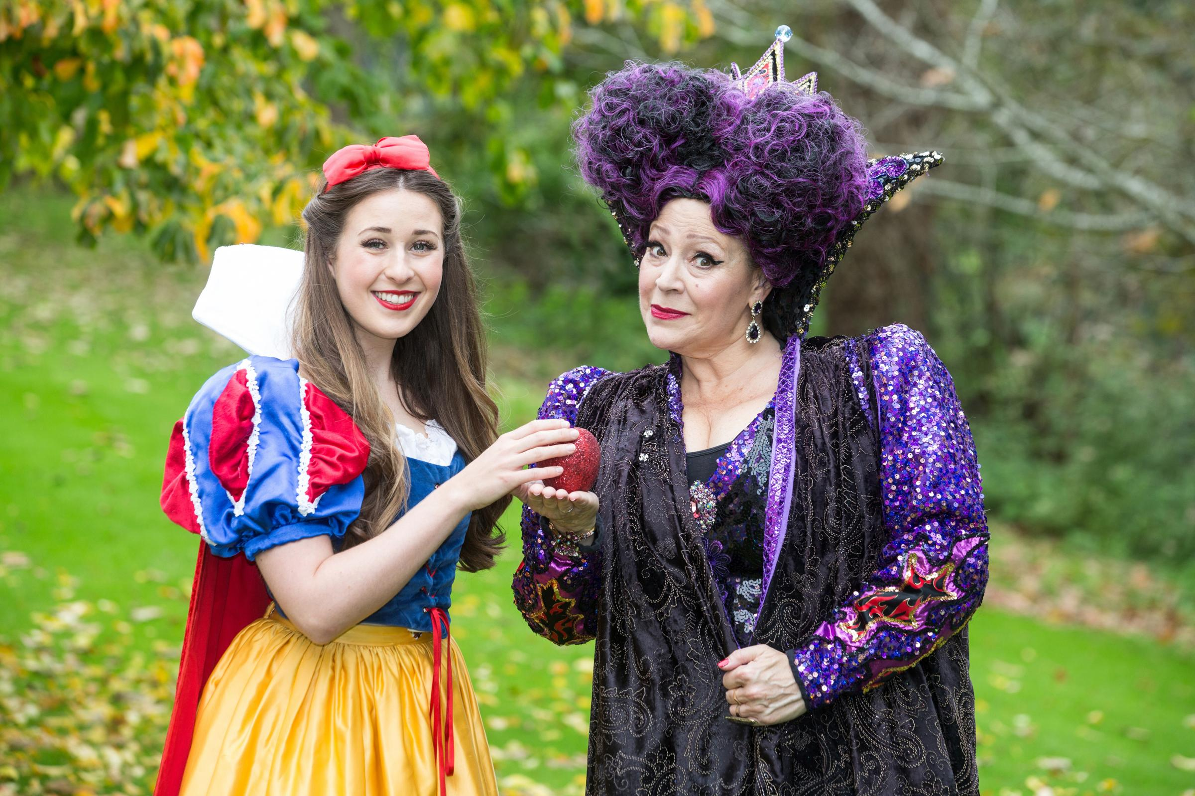 Snow White and The Seven Dwarfs on at the Theatre Royal Bath until January 7. Pictured, Devon Elise Johnson as Snow White and Harriet Thorpe as the Wicked Queen. Photo: Frela Turland.