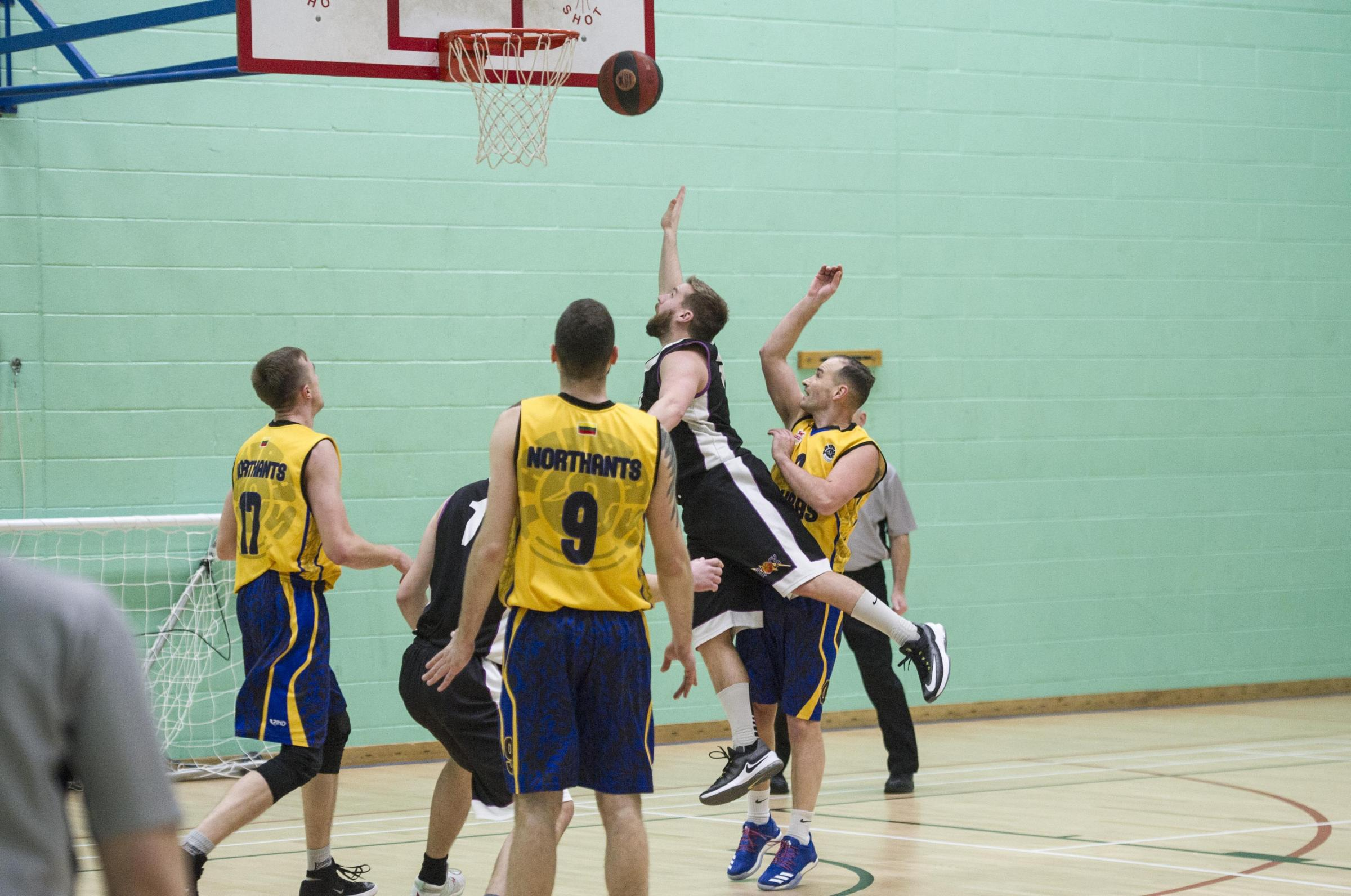 Swindon Shock's Lee Hobbis (black) drives towards the basket during their 102-89 defeat at home to Northants Taurus last weekend. PICTURE: DAVE COX