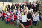 Manager Kate Adams with children, staff and parents at The Play Den. Picture: DAVE COX