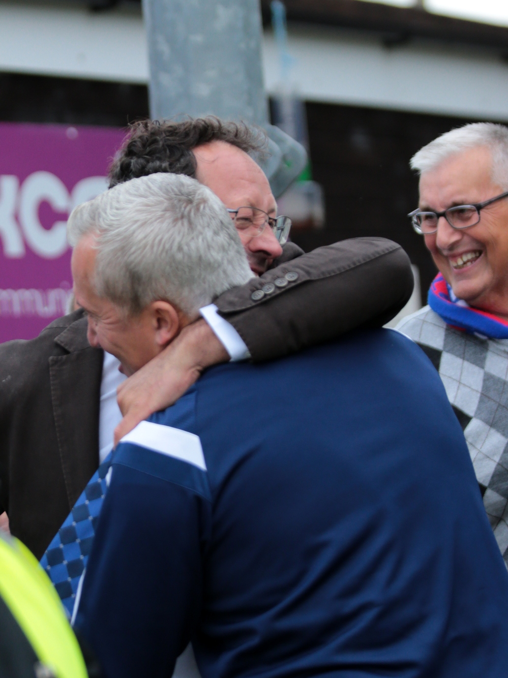 Supermarine chairman Jez Webb congratulates now-axed boss Dave Webb (blue) after his side's FA Cup win over Farnborough in September 2016