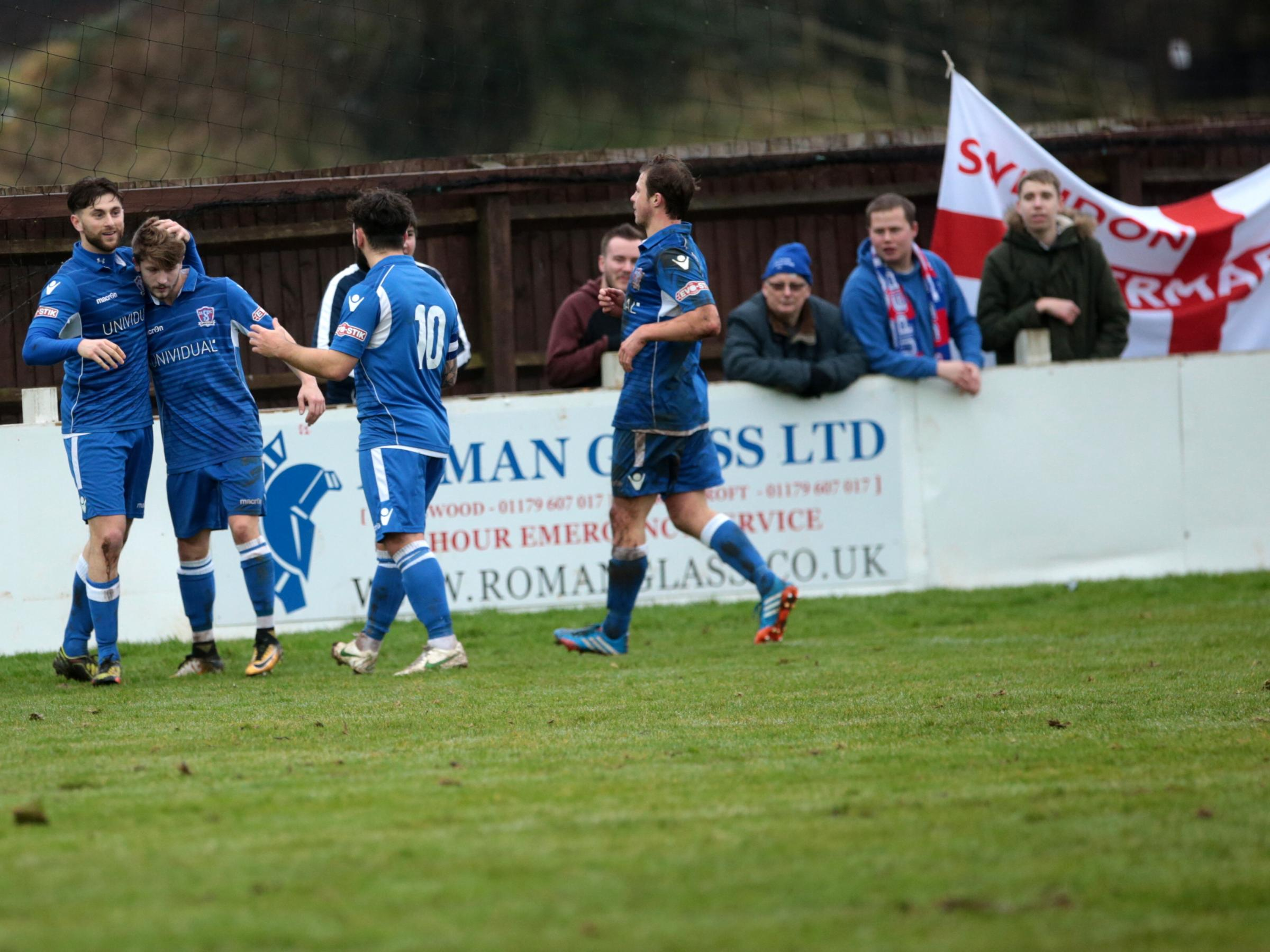 The Swindon Supermarine players celebrate after Brad Hooper (left) put them ahead during Saturday's 1-1 draw away at Bristol Manor Farm in Southern League West (Picture: JEFF YOUD)