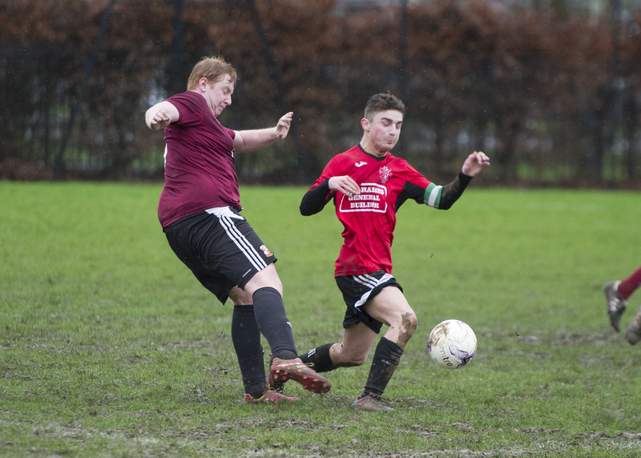Swindon AFC's Regan Cass (left) is challenged by Liam Wilkinson, of Highworth Town Development in their Swindon & District Division One clash on Saturday