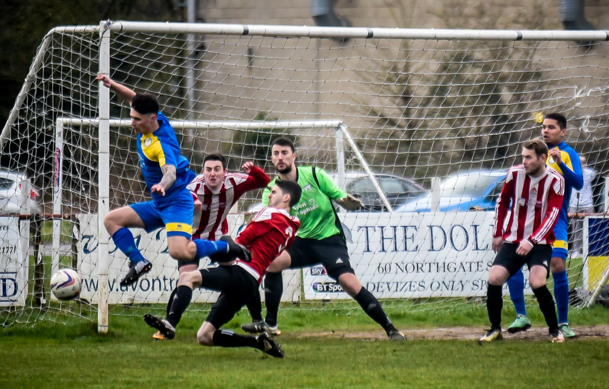 Royal Wootton Bassett Town Development (blue) attempt to flick the ball goalwards during their narrow 2-1 defeat away at Devizes Town Reserves in the Wiltshire League on Saturday. PICTURE: GLENN PHILLIPS