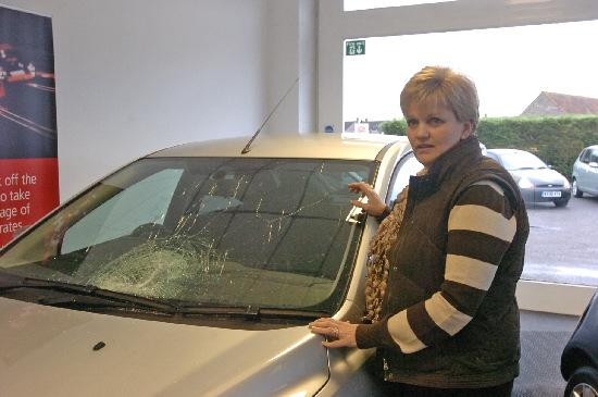 Sally Phillips with her windscreen that was shattered by a mysterious shard of ice