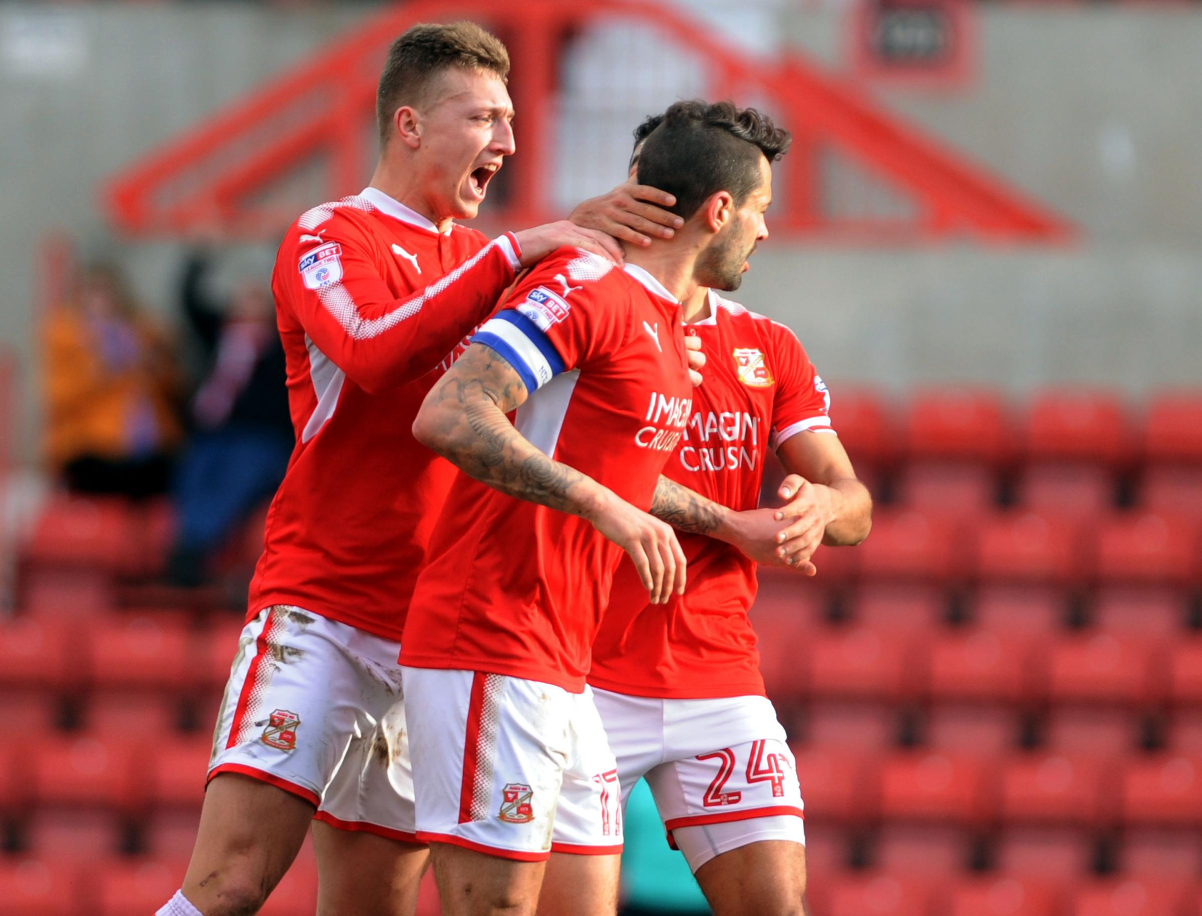 Luke Norris congratulates Marc Richards on a goal